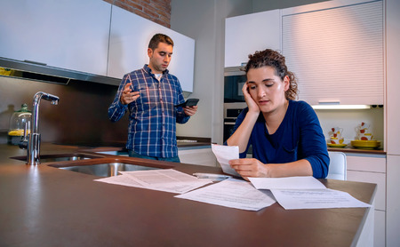 Young Couple trying to get out of debt